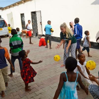 Projects Abroad volunteers play ball sports with children in Tanzania on our placement for teenagers